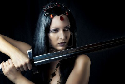 12120700-young-sexy-woman-warrior-holding-sword-in-hands-with-long-healthy-black-hair